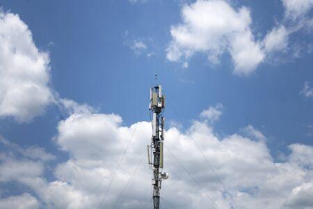 Telephone broadcast column against blue sky