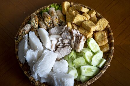 Close-up image of the disc:  bun dau mam tom is popular street food make from vermicelli with boiled meat, fried tofu, shrimp paste and green vegetables, cucumer and spice as chilli, lemon Imagens