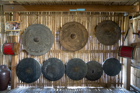 Phu Yen Province, Vietnam - July 21, 2019: Collection of ancient bronze gongs instruments in a display at the Sea Cliff of Stone Plates tourist area in Phu Yen province, Vietnam Stockfoto - 132420237