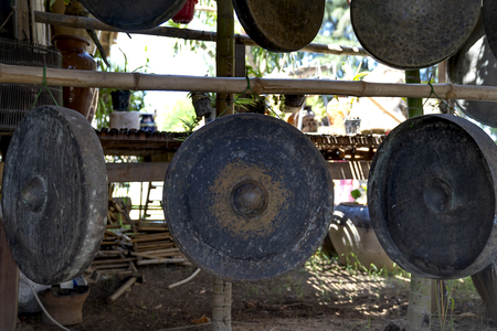 Phu Yen Province, Vietnam - July 21, 2019: Collection of ancient bronze gongs instruments in a display at the Sea Cliff of Stone Plates tourist area in Phu Yen province, Vietnam Stockfoto - 132420241