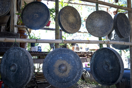 Phu Yen Province, Vietnam - July 21, 2019: Collection of ancient bronze gongs instruments in a display at the Sea Cliff of Stone Plates tourist area in Phu Yen province, Vietnam