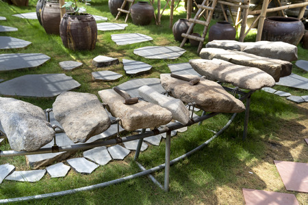 Phu Yen Province, Vietnam - July 21, 2019: Collection of ancient stones instruments in a display at The Sea Cliff of Stone Plates tourist area in Phu Yen province, Vietnam Stockfoto - 132420244