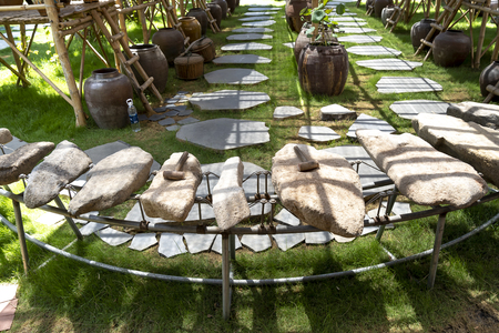 Phu Yen Province, Vietnam - July 21, 2019: Collection of ancient stones instruments in a display at The Sea Cliff of Stone Plates tourist area in Phu Yen province, Vietnam Stockfoto - 132420245