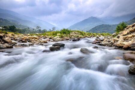 Beautiful scene of the stream at high mountains Mu Cang Chai, Yen Bai Province, Vietnam