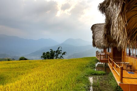 Hoang Su Phi Lodge Resort, Ha Giang Province, Vietnam - September 26, 2019: Wooden bungalows overlooking breathtaking views of mountains and terraces where guests can relax and mingle with nature cour Редакционное