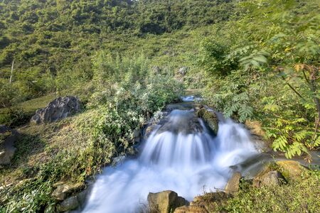 Beautiful waterfall in the mountains in Ngoc Con commune, Trung Khanh district, Cao Bang province, Vietnam.