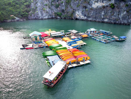 Colorful kayaks with limestone mountains background at Ha long bay, Vietnam