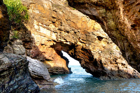 Cave on a sea cliff overlooking the sea in Nghe An province, Vietnam Zdjęcie Seryjne