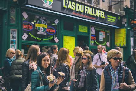 jewish group: Paris, France - April 21, 2016 - People line up to buy special Jewish food: Fallafel
