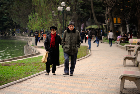 old couple walking: Hanoi, Vietnam - 10 March,2012: Old couple walking together around Hoan Kiem lake Editorial