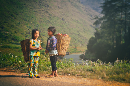 ha giang: Ha Giang, Vietnam - 02 November, 2012: Two young people go to work together at the mountain Editorial