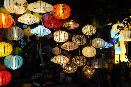hoi an: Hoi An, Vietnam - July 15, 2012: Lanterns are lighted up at the front of the small shop