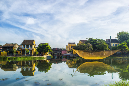 Hoi An, Vietnam - September 02, 2013: People are walking around the river in the morning