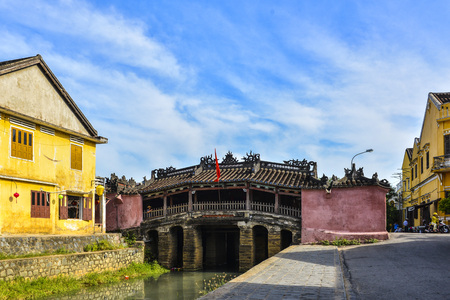 hoi an: Hoi An, Vietnam - September 02, 2013: The woman is on the Japanese covered bridge