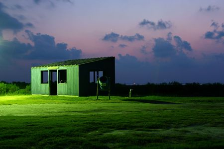 fish cleaning hut near the Gulf of Mexico after sunset Stock Photo