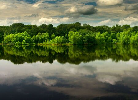 reflection of clouds on a calm lake Stock Photo