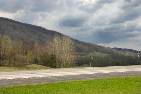 highway though upstate New York mountains Stock Photo