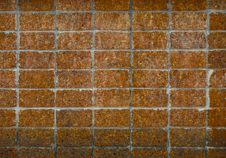 Front view of old grunge laterite wall texture.