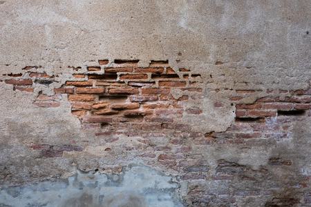 Cracked and decayed brick stucco wall texture background weathered long time ago. Standard-Bild