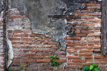 Cracked and decayed brick stucco wall texture background weathered long time ago. Stock Photo