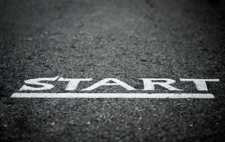 Close up of a start letters on the asphalt floor with vignette effect, concept photo of the starting point for doing something, selective focus.