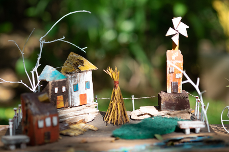 Wooden colorful sweet home, item for decoration in the small garden, selective focus.
