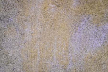 Yellow urban stucco wall texture background, tropical style.