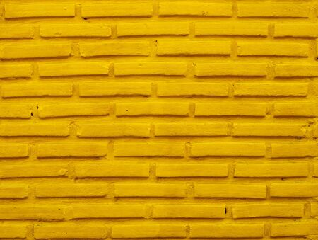 Brick wall background with yellow color. Stock Photo