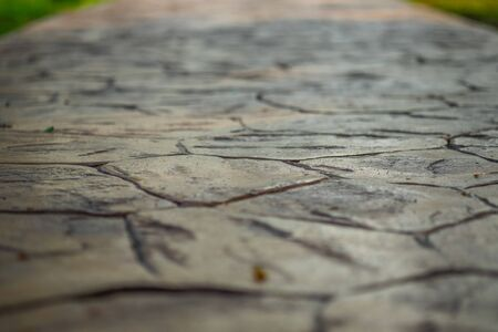 Close up view of walkway concrete stamped material, selective focus.