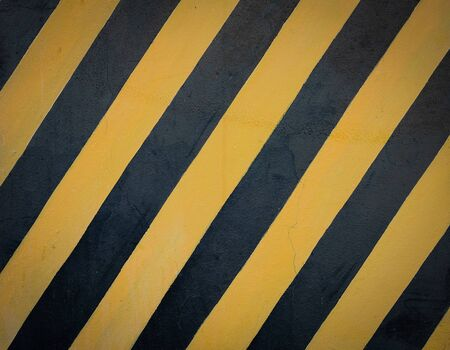 Striped black and yellow grunge background, warning signage.