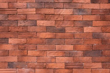 Ancient red brick wall seamless pattern background. Stock Photo