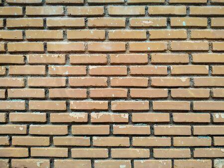 Old grunge orange brick wall background.