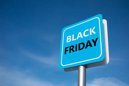 Black friday sales signage, street signage concept with bluesky background. Imagens