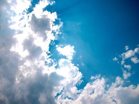 clouded sky and sun rays