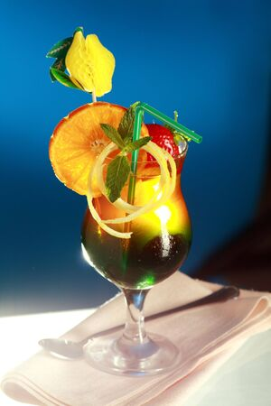 appealing: Appealing cool fruity cocktail with blue background