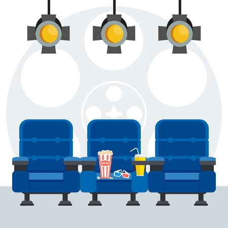 Auditorium and three blue comfortable armchairs in the cinema under spotlight.