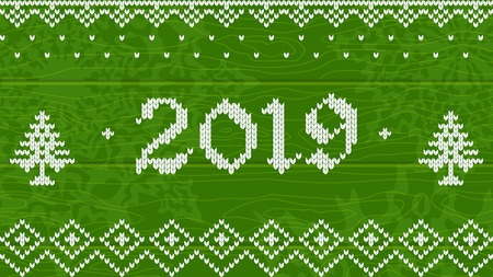 2019 knitted on green wood
