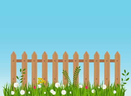 A wooden fence, a hedge near with a flower bed. Banque d'images - 122346934