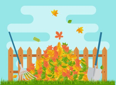 Pile of autumn leaves lies under the fence.