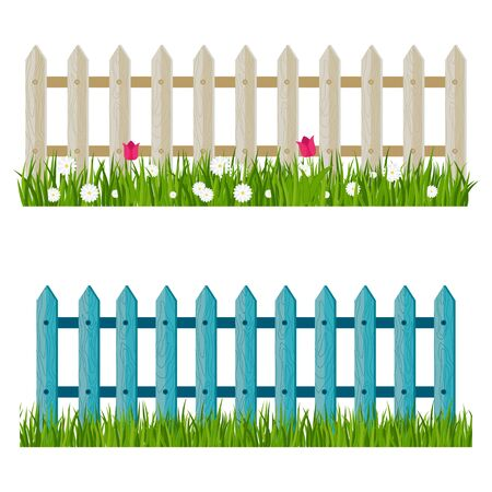 A wooden fence, a hedge near with a flower bed.