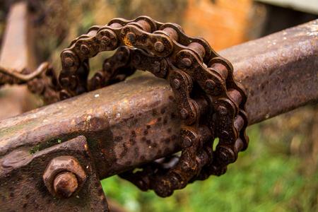 constrict: old rusty metal caterpillar, winding iron stick