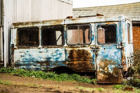 metallic house style grunge, old bus at the dump