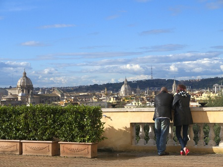 couple scanning the rooftops of Rome ( releases can be sent to you)
