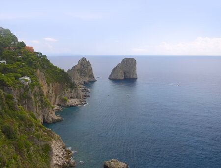 The Faraglione Rocks on the Island of Capri, Campania, Italy photo