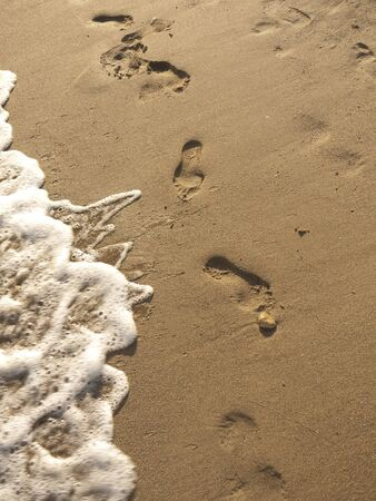 sun bathers: Footprints in the sands of Torremolinos Spain