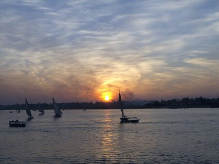 Sun setting over the River Nile in Egypt photo