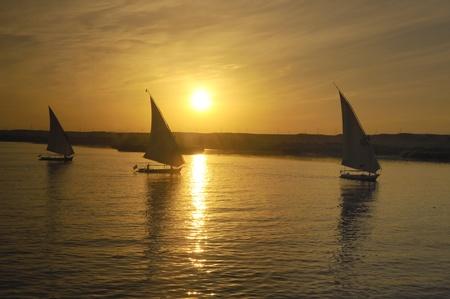 Setting Sun over de rivier de Nijl op een Nile Cruise, Egypte Stockfoto