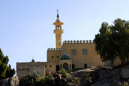 Mosque on the banks of the River Nile in Egypt photo