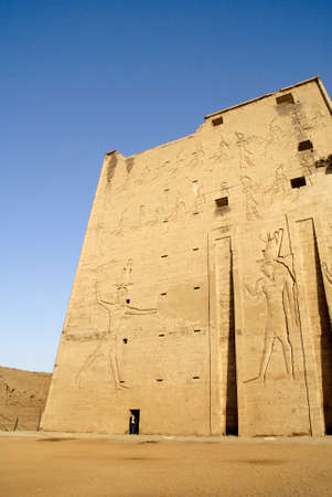The Temple of Edfu is an ancient Egyptian temple located on the west bank of the Nile in the city of Edfu. It is the second largest temple in Egypt after Karnak and one of the best preserved photo