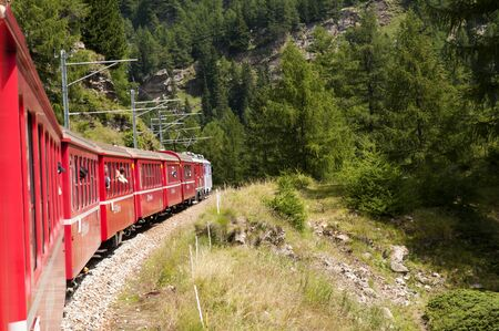 The Bernina Express from Switzerland to Italy.This little red train takes you on one of the 10 greatest train journeys in world.It runs from Tirana in Italy to St Moritz and onto Lake Lugano. It passes glaciers and mountains,ski slopes and Swiss cottages